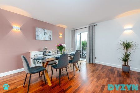 Six seater dinnning table next to the balcony is perfect for entertaining