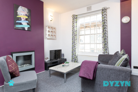 Smart TV, Fireplace and confy seating make for the perfect area to relax