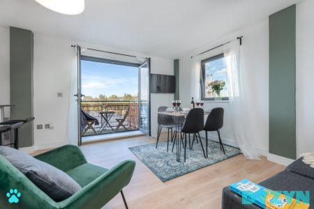 Spacious living and dining area open the balcony doors and let the summer in.